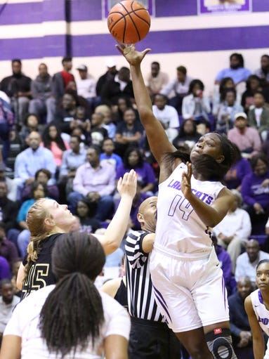 Haywood Laquita Callaway wins the opening tip during