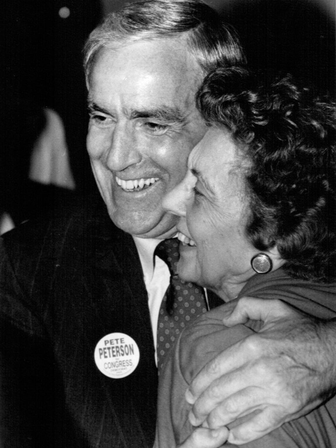 Peterson hugs a supporter during a campaign victory