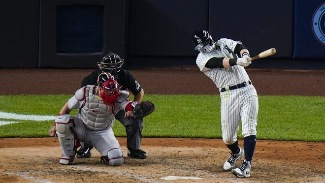 New York Yankees' Clint Frazier hits a three-run home run during the sixth inning of a baseball game against the Boston Red Sox Saturday in New York.