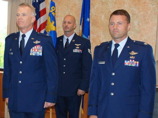 A throng of aviators and rescue wing reservists gathered at the base golf course as Col. Christopher P. Hannon relinquished his 8-year command of the 301st Rescue Squadron at Patrick Air Force Base Aug. 16 to his director of operations, Lt. Col. D. Brent Baysinger.