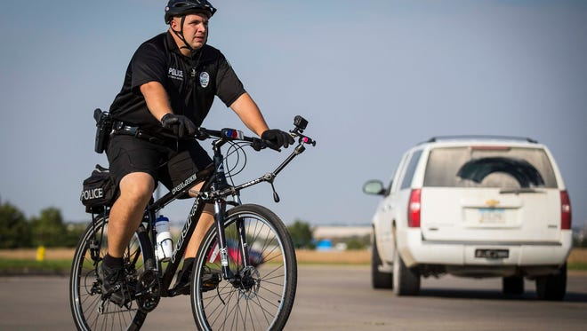 Norwalk officer Brad Criswell on bicycle patrol Tuesday Sept. 29, 2015. In Norwalk, a suburb of 10,000 just south of Des Moines – the bicycle seems to be the best compromise between mobility and personability.