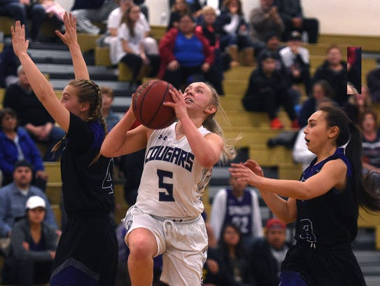 Spanish Springs' Megan Gower (5) drives to the basket