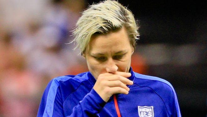 United States of America forward Abby Wambach walks off the field following her final appearance with the team.