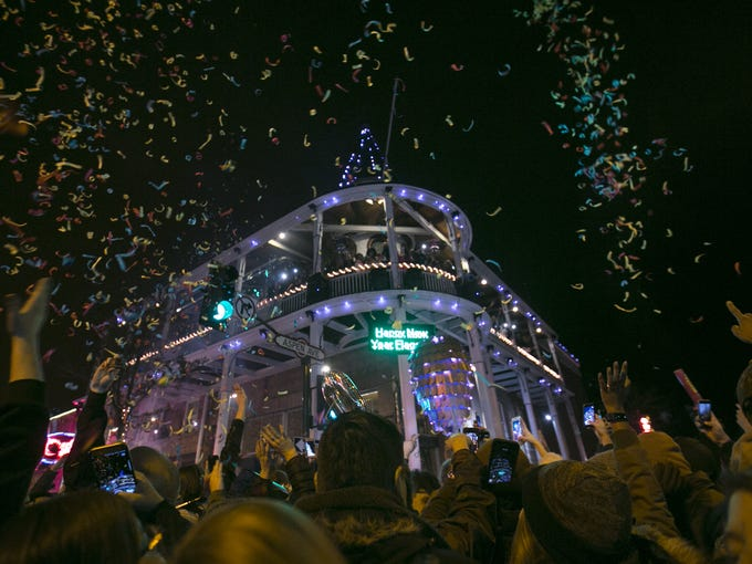 The crowd celebrates the turn of the New Year in front