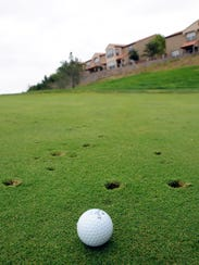 A golf ball rests on a green in the back nine of Sonoma