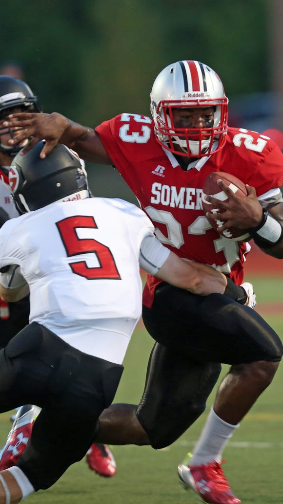 Somers' Messiah Horne tries to get around Rye's Tyler Reno during their game at Somers High School on Sept. 4, 2015.