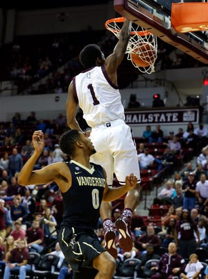 Mississippi State guard Fred Thomas (1) dunks over Vanderbilt's Shelton Mitchell for two of his 10 points Saturday.