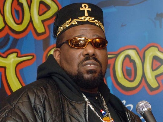 """Afrika Bambaataa speaks at the Smithsonian's National Museum of American History in New York in 2006. Hip-hop began in the early 1970s as an alternative to gang activity. Before the music was recorded, founding fathers like Bambaataa - whose slogan was """"peace, love, unity and having fun"""" - would play Malcolm X's voice over instrumental break beats."""