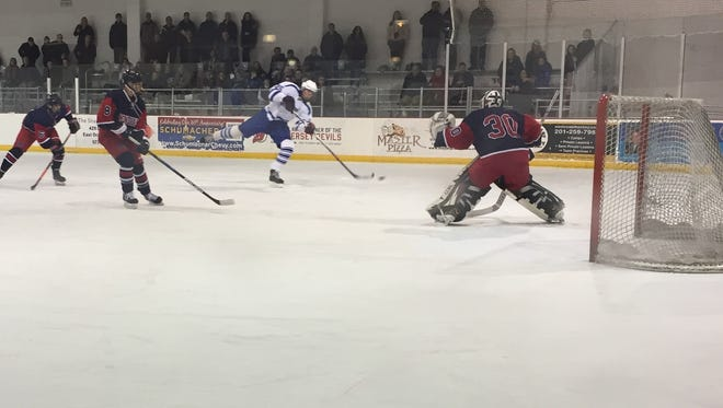 Spencer Brown rips a shot on goal during the second period against Mendham.
