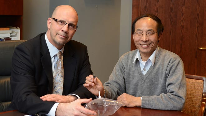 Dr. Michael Bousamra (left) and colleague Xiaoan Fu worked with a team of University of Louisville researchers to discover a test that may someday help diagnose lung cancere earlier.