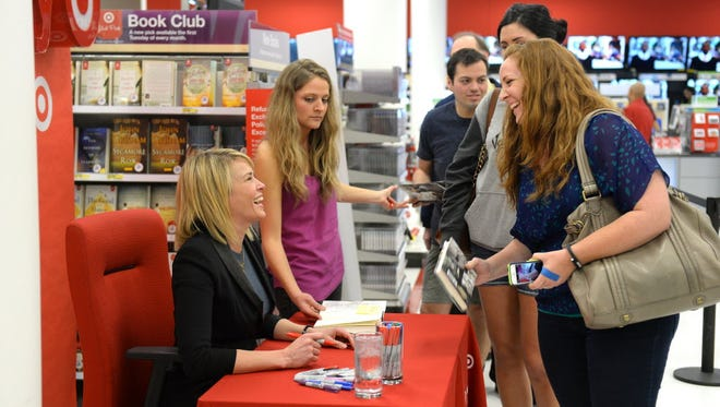 "Chelsea Handler signs the Target exclusive edition of her newly released book ""Uganda Be Kidding Me"" for a crowd of fans at Westwood City Target on March 10, 2014 in Westwood, California."