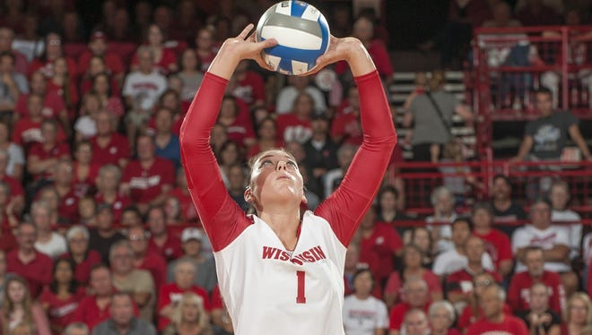 Lauren Carlini, a four-time All-American in volleyball for the Wisconsin Badgers, was named as the Sullivan Award winner on Tuesday night in New York.