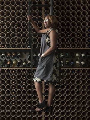 Regina Gaines co-owns the House of Pure Vin wine shop on Woodward. In 2014, when she started negotiating for the space, she said some African-Americans didn't feel part of the downtown boom.