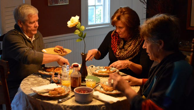 Ellen Passman dines with guests in her home, the Victorian B&B in Milton.