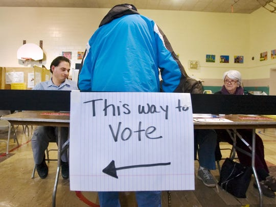 A voter checks in at the Ward 3 polling place at the Lawrence Barnes School on town meeting day in Burlington on Tuesday March 3, 2009.