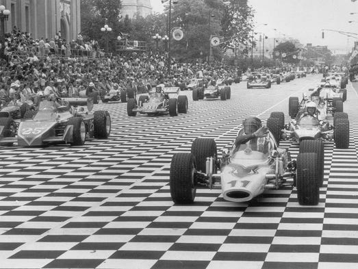 Shriners pilot miniature race cars down Pennsylvania St. during the 500 Festival Parade, May 25, 1981.