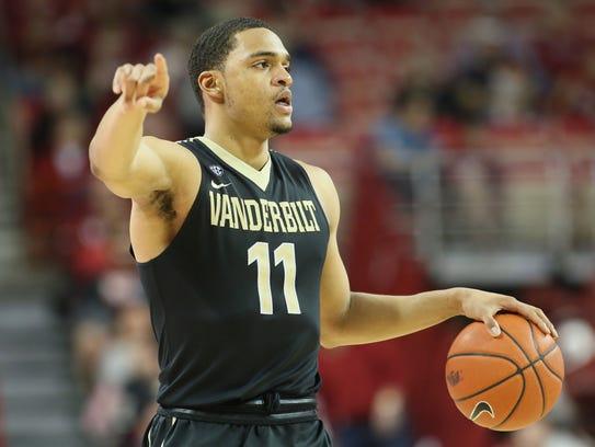 Vanderbilt forward Jeff Roberson (11) dribbles the