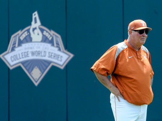 FILE - In this June 17, 2011, file photo, Texas' coach Augie Garrido surveys the playing field during NCAA college baseball practice at TD Ameritrade Park in Omaha, Neb. Garrido, who won three national baseball championships at Cal State Fullerton and two more at Texas, has died, the University of Texas announced Thursday, March 15, 2018. He was 79. (AP Photo/Dave Weaver, File)