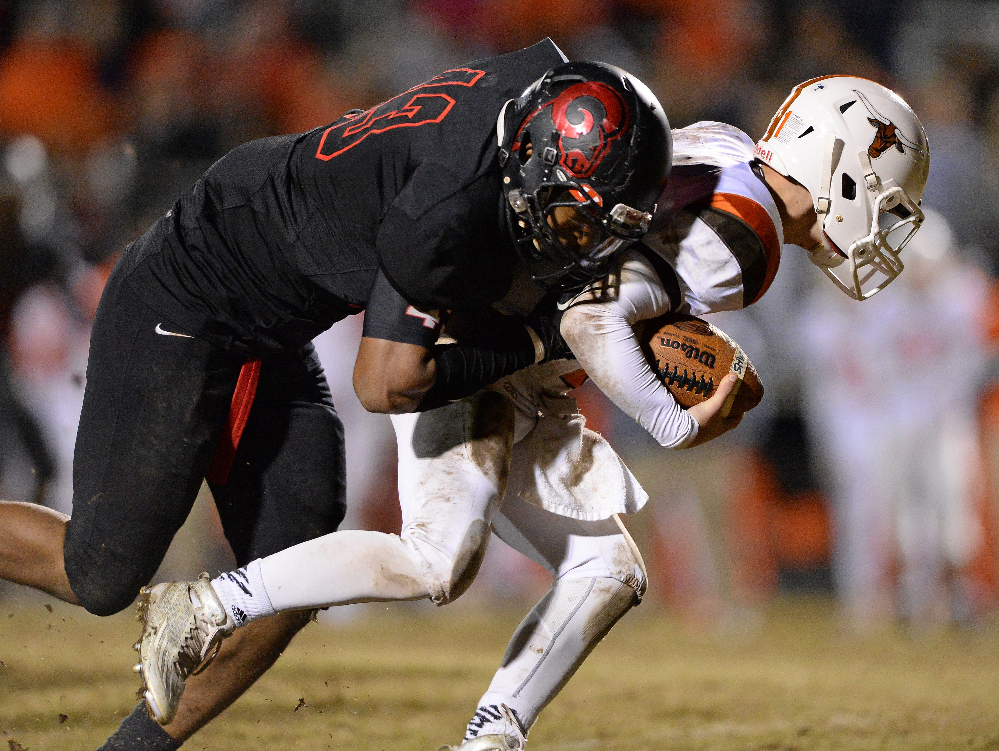 Hillcrest's Brandon Peppers (13) sacks Mauldin quarterback Mitch Norman (11) during the first round of the Class AAAA Division-I playoffs Friday, November 20, 2015 at Hillcrest High.