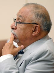 Former Sen. Phil Griego listens during a hearing in District Court, Tuesday, July 5, 2016 in Albuquerque, N.M. District Court began hearing testimony from state lawmakers on accusations that former Sen. Phil Griego used his public office to profit from the sale of a state-owned building.