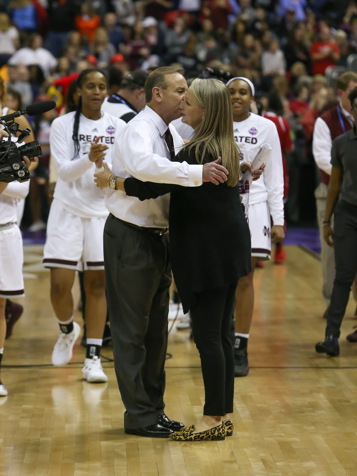 Vic Schaefer hugs his wife Holly after he coached Mississippi State to a Final Four win over Louisville in 2018. Photo by Keith Warren
