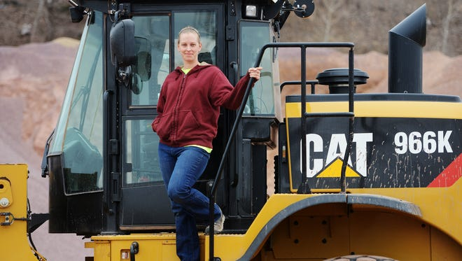 Lori Marken is a hot plan loader operator at Myrl & Roy's Paving in Sioux Falls, March 26, 2015.