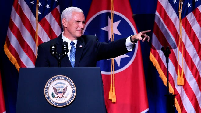 Vice President Mike Pence points to the crowd during the Tennessee Republican Party's Statesmen's Dinner at Music City Center in Nashville on Aug. 3, 2017.