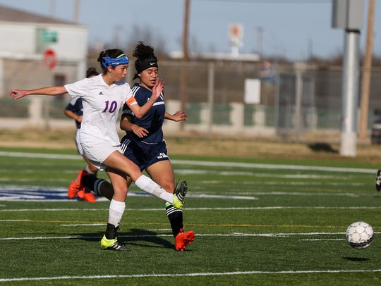 San Angelo Central High School's Briana Caudle (left) made her plans official on Wednesday to play for Hardin-Simmons University next season.