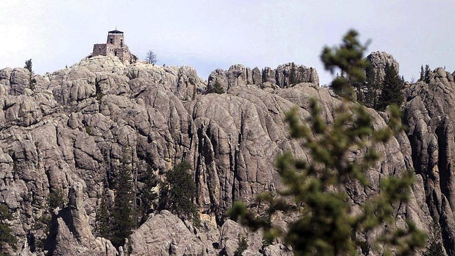 """The Harney Peak lookout tower is near Hill City. A U.S. Geological Survey publication titled """"Elevations and Distances in the United States"""" includes a footnote designating Harney Peak as the """"Highest summit east of the Rocky Mtns."""""""