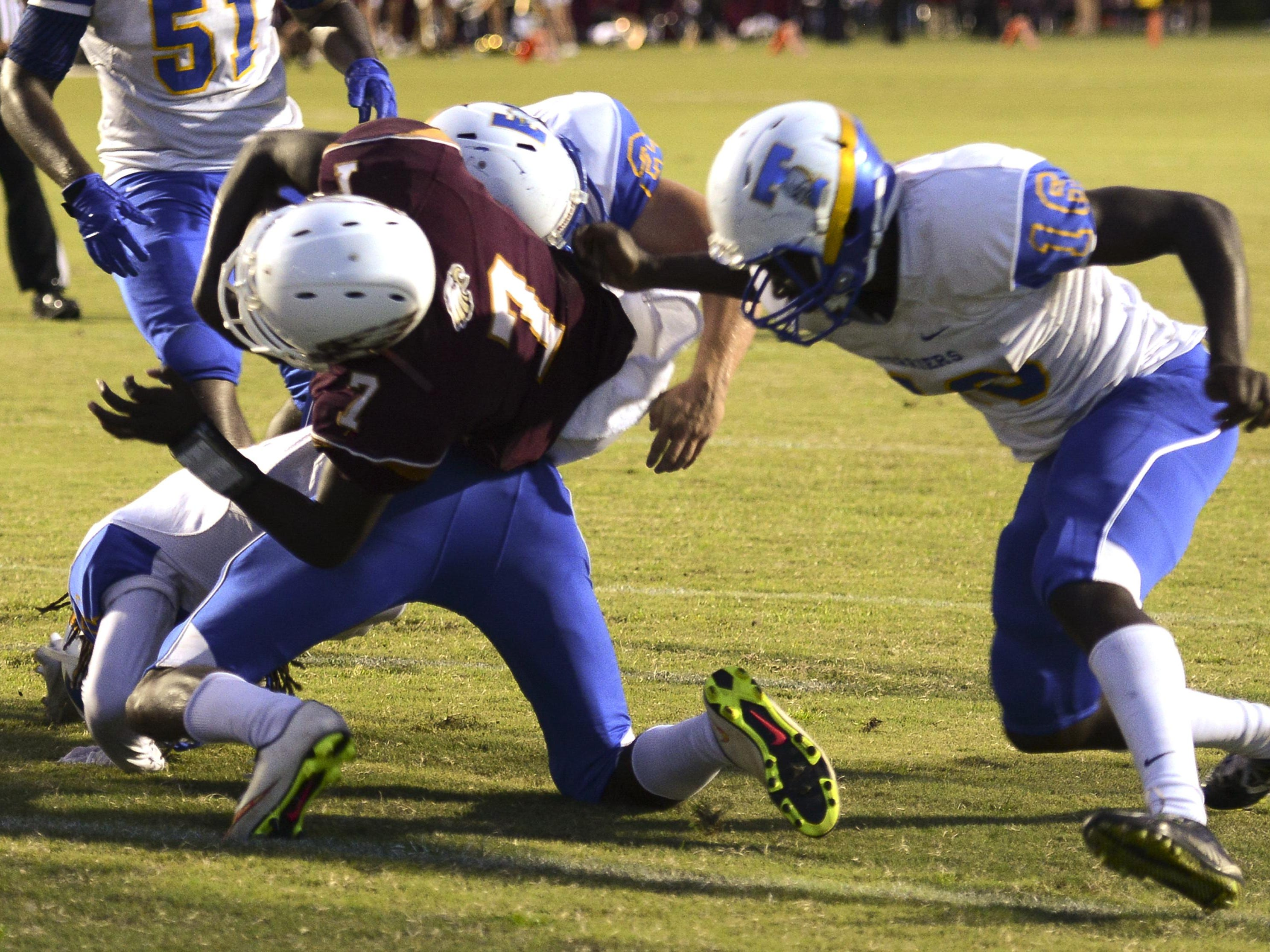 Astronaut's Devell Taylor dives into the end zone during Friday's game against Titusville.