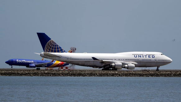A United Airlines jet sits on a runway July 11, 2017,