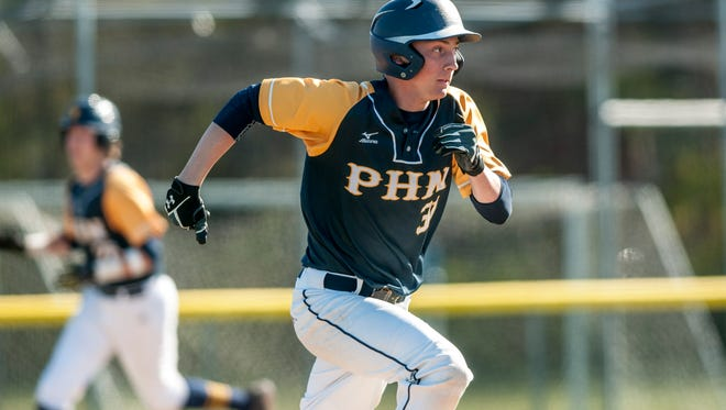 Port Huron Northern's Andrew MacLean runs for first during a baseball game Monday, May 15, 2017 at Port Huron Northern High School. Northern beat St. Clair 11-1 in a five innings.