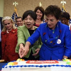 Rep. Doris Matsui (D-Calif.), and Rep. Jan Schakowsky (D-Ill.) cut a special cake to celebrate the 50th anniversary of Medicare and Medicaid on Capitol Hill on July 29, 2015, in Washington, D.C.