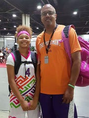 Cori Allen, 12, with her dad and former Tennessee basketball