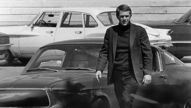 """Steve McQueen, starring in the title role of """"Bullitt,"""" steps out of the Mustang after a 140 mph pursuit through the hilly streets of San Francisco."""