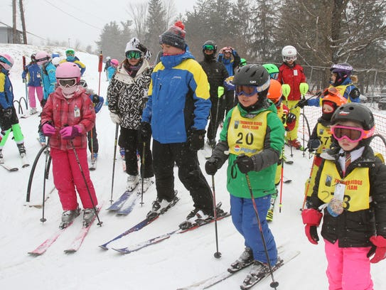 Skiers and snowboarders enjoy the fresh falling snow