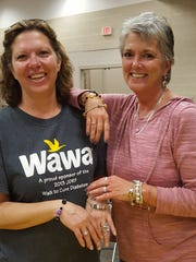 Mary Liz Ray (left) and Gwen Yacovelli show off festive