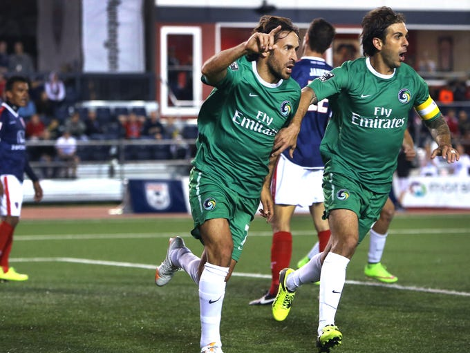 New York Cosmos standout player Raul holds up one finger