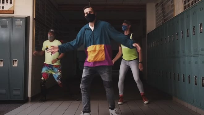 """Zeeland Christian School's Peter Jenkins, center, reworked Vanilla Ice's 1989 hit """"Ice, Ice Baby"""" into a music video reminding students to wear masks while at school."""