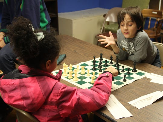 Dominic Sicola played chess at SCLSNJ's Watchung Library branch with Calee Goldstein during The King's Castle program.