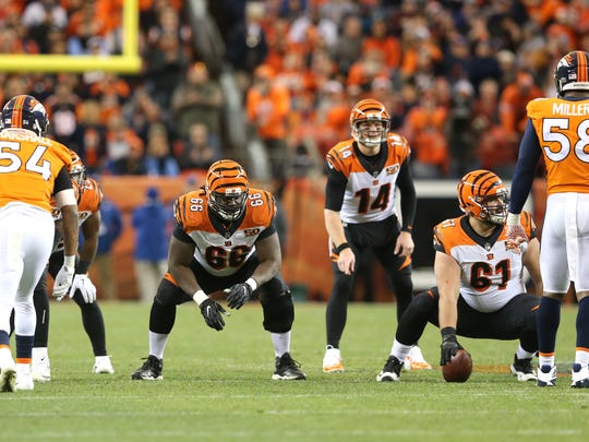 Cincinnati Bengals offensive guard Trey Hopkins (66) and Cincinnati Bengals center Russell Bodine (61) get set for the snap in the third quarter during the Week 11 NFL game between the Cincinnati Bengals and the Denver Broncos, Sunday, Nov. 19, 2017, at Sports Authority Field at Mile High in Denver, Colorado.