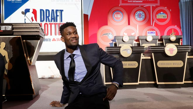 DeAndre Ayton from Arizona sits on the stage before the NBA basketball draft lottery Tuesday, May 15, 2018, in Chicago.