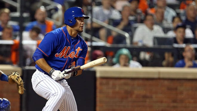 New York Mets left fielder Michael Conforto (30) grounds out with an RBI against the Los Angeles Dodgers during the fifth inning at Citi Field.