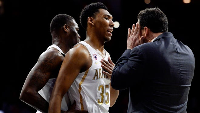 Jan 26, 2017: Arizona Wildcats head coach Sean Miller (R) talks to guard Allonzo Trier (35) during the second half against the Washington State Cougars at McKale Center. The Wildcats won 79-62.