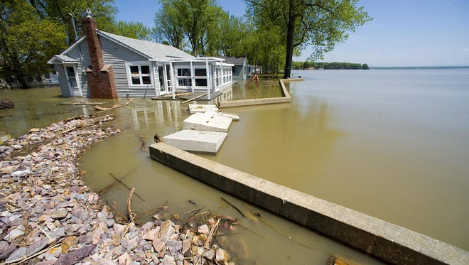 In this May 2011 file photo, lakeshore property is inundated as high water from Lake Champlain  to flooded Colchester Point Road in Colchester.
