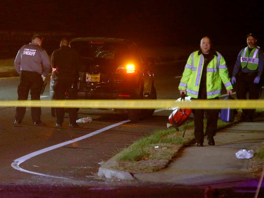 Lakewood Police investigate the scene of a fatal pedestrian accident on Shorrock Street, south of Route 70, in the township Monday evening, December 5, 2017.