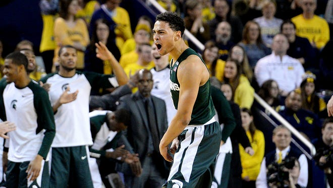 Spartans guard Bryn Forbes celebrates after hitting a three pointer in the first half Saturday, Feb. 6, 2016 at Crisler Center against Michigan in Ann Arbor.