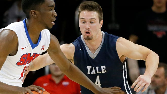 Yale's Jack Montague, right, defends against SMU guard Shake Milton on Nov. 22, 2015.