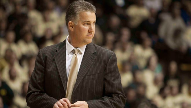 Purdue coach Matt Painter stands on the sidelines against North Carolina State at Mackey Arena. The Boilermakers won 66-61.