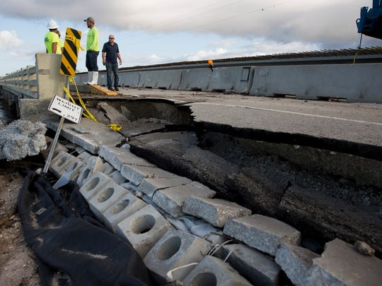 Engineers assess damage done to the bridge connecting